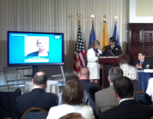 Dr. Benjamin presenting Terry with the Surgeon General's medal.