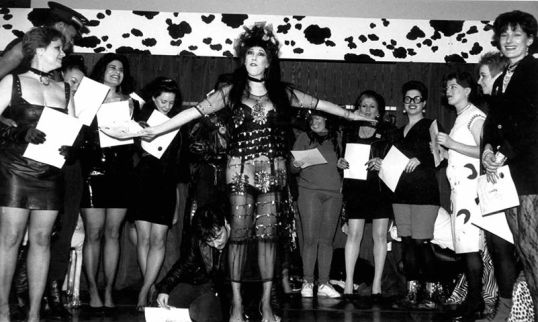 """Caption: In 1991, Iris De La Cruz, AIDS activist, writer and performer who was also a member of the bisexual community died.  Iris wrote the popular news column """"Kool AIDS on Ice"""" until her death. Iris's House was founded in 1992 as the """"nation's first HIV/AIDS agency to provide family focused services to women of color infected and affected by HIV"""". Named in honor of Iris De La Cruz, the agency currently erases de la Cruz's bisexuality. Photo Credit: Annie Sprinkle, Veronica Vera and Iris De La Cruz in an undated photo. Photo Credit: Efrain Gonzalez, Facebook Bi History Group"""