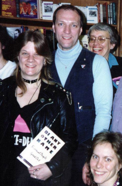Caption: Liz Highleyman (left) and other contributors to the Bi Any Other Name anthology, Cliff Arneson, Robyn Ochs, and Bobbie Keppel. In 1992, Liz Highleyman co-founded the ACT UP/Boston IV League needle exchange, one of the first in US. Highleyman would go on to become a prolific writer, editor and influencer in the HIV/AIDS community and is editor-in-chief and publisher of HIVandHepatitis.com. Photo Credit: Courtesy of Liz Highleyman.