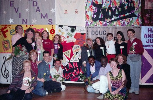 """Caption: BiPOL San Francisco produces the 1990 National Bisexual Conference, with bisexual health as one of eight workshop tracks. """"NAMES Project"""" AIDS Memorial Quilt was displayed with bisexual quilt pieces; 465 people attend representing 20 states and five countries. Note the special place Dr. Alan Rockway's quilt has in the photo above. Photo Credit: Efrain Gonzalez, Facebook Bi History Group - 1990 1st National Bisexual Conference"""