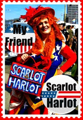 """Also in 1990, bisexual activist Carol Leigh, """"a.k.a. Scarlot Harlot, is arrested at 6th International AIDS Conference in full flag regalia during women's protest against scapegoating of prostitutes in AIDS crisis. Leigh would also go on to coin the term """"sex worker"""" and be featured in a 2012 documentary, """"My Friend Scarlot Harlot"""". Photo Credit: """"My Friend Scarlot Harlot"""" Facebook Page https://www.facebook.com/pages/My-Friend-Scarlot-Harlot/271942939539757?sk=timeline"""